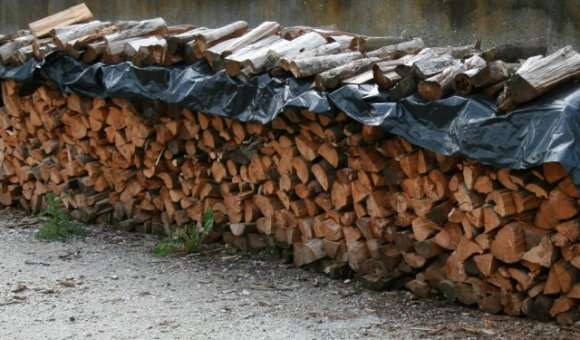 Wood drying under a sheet